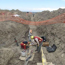 Power crew working in a trench