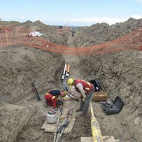 Linesmen working in a trench